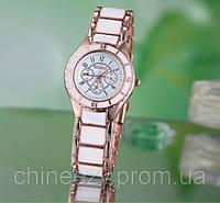 Женские кварцевые часы Rosra с покрытием под золото и белыми керамическими вставками. Копия Chanel Watch