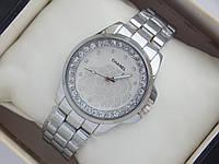 Женские кварцевые часы Chanel стального цвета с цветком на циферблате