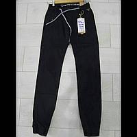 Котоновые подростковые брюки на мальчика чёрного цвета на манжет GRACE