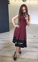 Эффектное женское платье приталенного фасона с пышной юбкой в складку со вставками сетки габардин