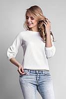 Эффектная женская блуза из структурного трикотажа белая
