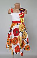 Красивое детское летнее платье на бретельках украшенное цветами