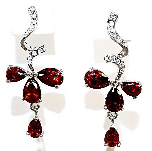 Серьги вечерние.Камень: бордовый и белый циркон. Высота серьги: 3,5 см. Ширина: 15 мм.