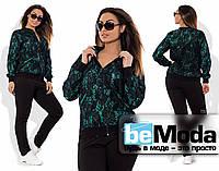 Эффектный женский спортивный костюм большого размера из гипюровой кофты на змейке и трикотажных брюк зеленый