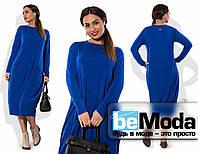Привлекательное женское платье большого размера необычного кроя с карманами по бокам синее