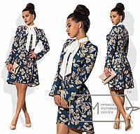 Платье-трапеция мини из костюмки с расклешённой асимметричной юбкой, воланами