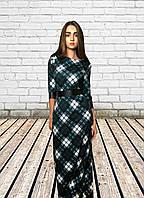 Женское длинное платье в клетку из трикотажа и экокожи