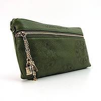Клатч кожаный Louis Vuitton зеленого цвета