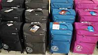 Качественный чемодан на колесиках середний   4 цвета