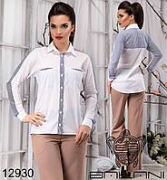 Элегантная блуза с карманами на груди,декорирована вставками в полоску.