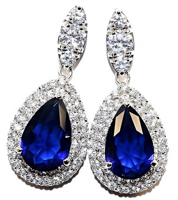 Серьги вечерние.Камень: белый и синий циркон. Высота серьги: 3,5 см. Ширина: 15 мм.