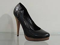 Туфли женские кожаные на высоком каблуке