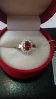 Серебряное кольцо с золотом красный