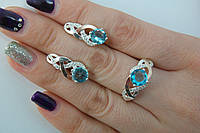 Комплект серебряных украшений с голубыми циркониями и золотом