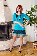 Оригинальное изящное платье из трикотажа и кружевной отделки.