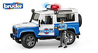 Игрушка Bruder джип Полиция Land Rover Defender, свет и звук, + фигурка полицейского 1:16 (02595)