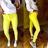 Женские яркие желтые джинсы