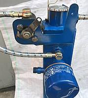 Гидробак с фильтром  мтз-80 может коплектоваться  устройством блокировки