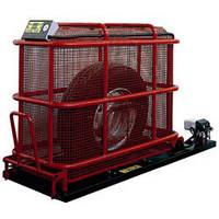 Защитная клетка для безопасной взрывной накачки грузовых шин с подъемным механизмом.