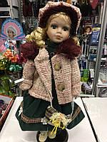 Кукла фарфоровая в одежде зимней