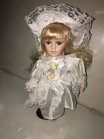 Кукла фарфоровая высота 20 см