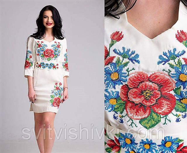 64a3eefbb1992d2 Эксклюзивное женское платье на белом габардине украшенное вышивкой  крестиком. К нему в комплекте прилагается пояс.Вышивка украшает грудь,  рукава и низ ...