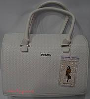 Белая женская сумка- плетенка