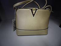 Золотая сумка в стиле Louis Vuitton