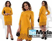 Оригинальное женское платье с перфорацией на рукавах и по краю низа желтое