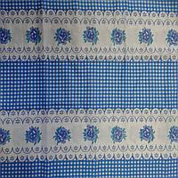 Ситец с голубой клеточкой и цеточком белом фоне