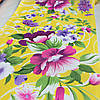 Вафельная ткань с яркими цветами на желтом фоне, ширина 40 см