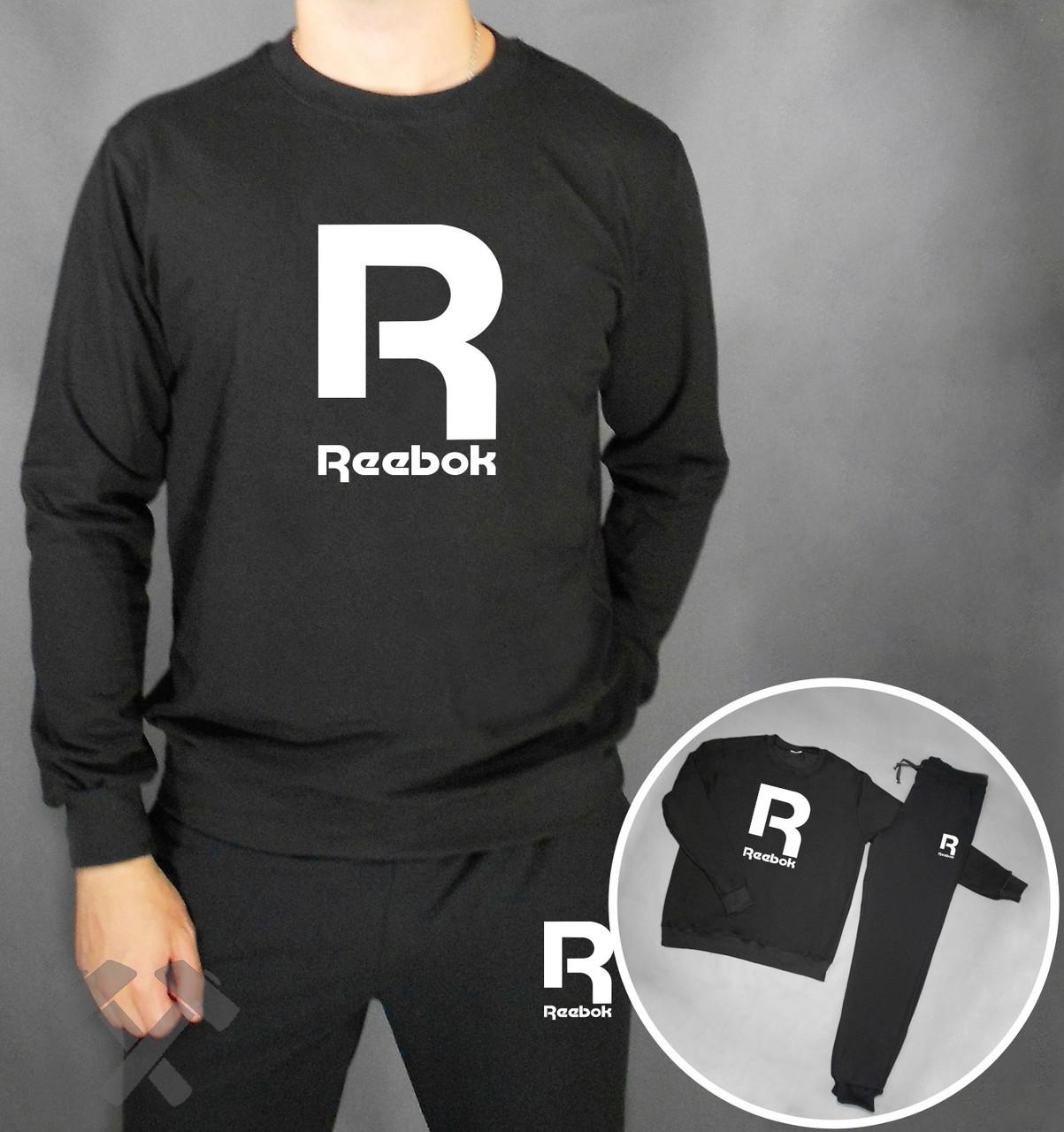 Спортивный костюм Reebok черного цвета с белым логотипом на груди