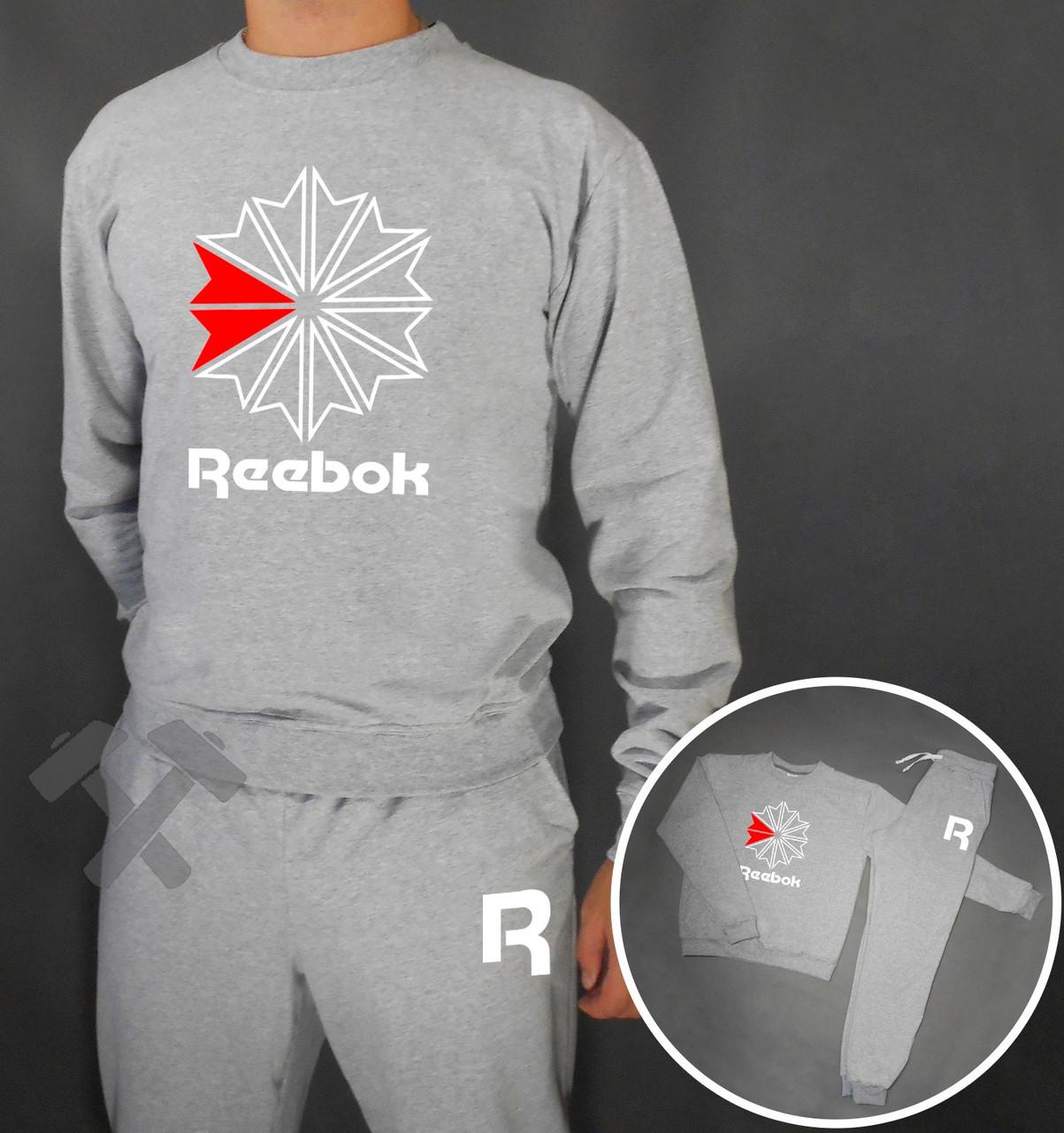 Спортивный костюм Reebok серого цвета с бело-красным логотипом на груди
