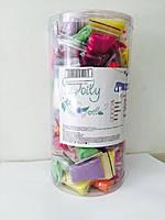Одноразові трусики-стрінги з рюшами в тубусі мікс S/M Doily Colorful 75 шт