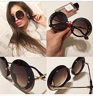 Солнцезащитные очки с круглыми стеклами
