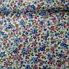 Ткань с мелкими голубыми и розовыми цветами