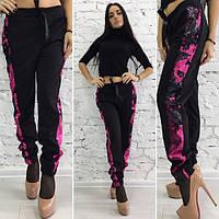 Женские черные брюки с пайетками