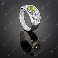 Серебряное кольцо с хризолитом и цирконами. Артикул П-426