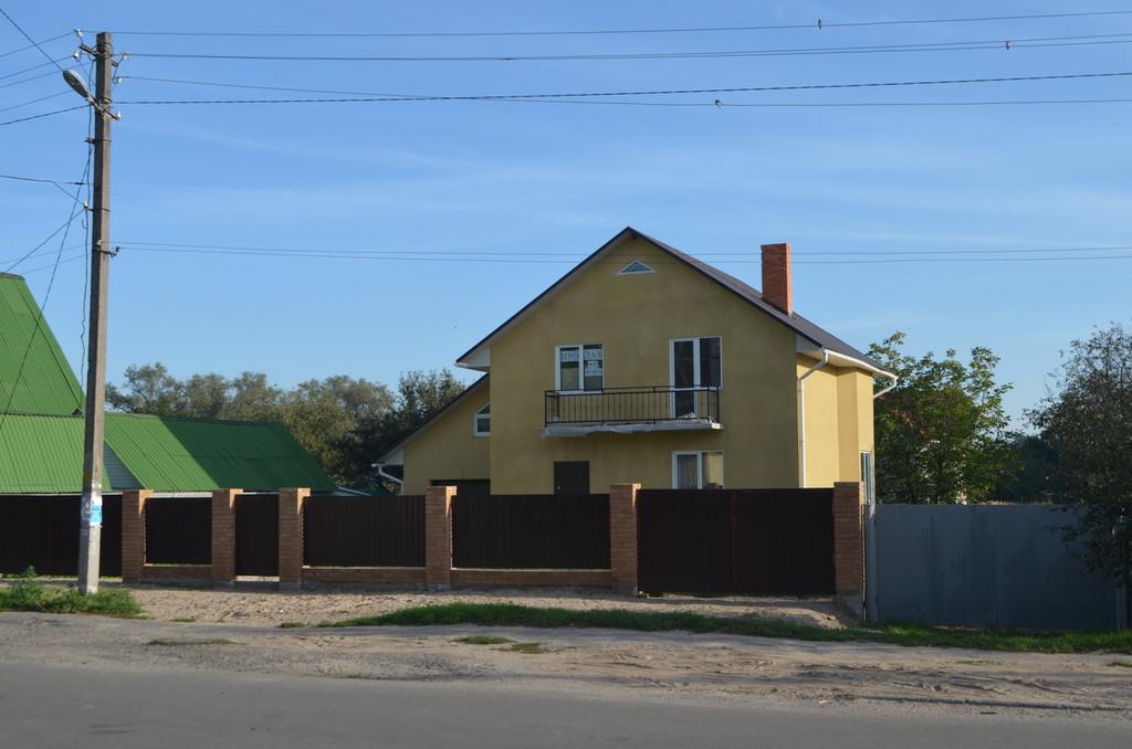 Дом из кирпича керамического под шубой 5