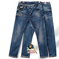 Молодёжные мужские джинсы зауженные к низу оригинального синего цвета с потёртостями Турция.
