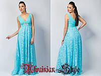 Голубое днотонное вечернее платье в пол без рукавов