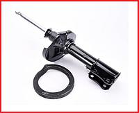 Амортизатор передний левый газомаслянный KYB Suzuki Baleno (95-) 333313