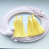 Дизайнерские серьги женские желтого цвета.