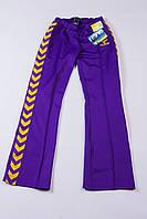 Трикотажные спортивные штаны женские в обтяжку фиолетовые hummel L