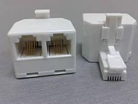 1001     Телефонный переходник (1штекер - 2 гнезда) 6Р4С белый