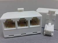 1002     Телефонный переходник (1штекер - 3 гнезда) 6Р4С белый