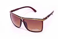 Модные солнцезащитные очки в интересной оправе