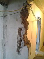 Исправления брака после сверления и долбления перфораторами, молотками несущих стен для получения (проемов)