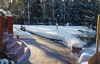 Очищення тротуарної плитки взимку