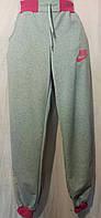 Женские спортивные штаны серые на манжете  Nike